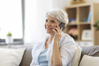 A woman receives good news on the phone